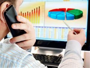 bigstock-Analyzing-data-on-computer--20769704