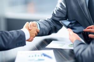 bigstock-Business-handshake-42882412